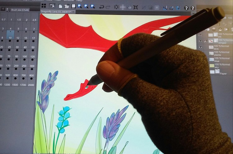 Wren works on a recent digital painting.