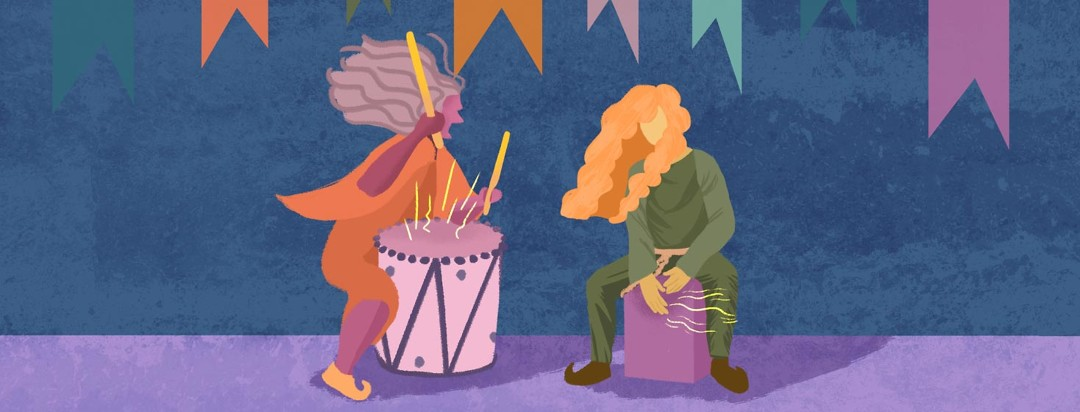 Two women drumming