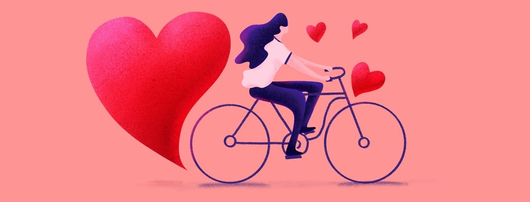 woman riding bike surround by hearts