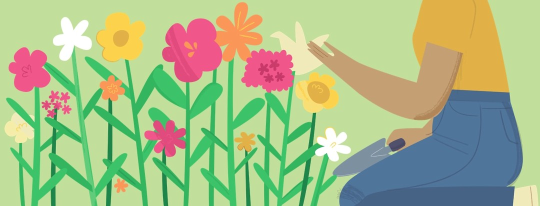 Woman kneeling in her garden admiring the flowers she grew