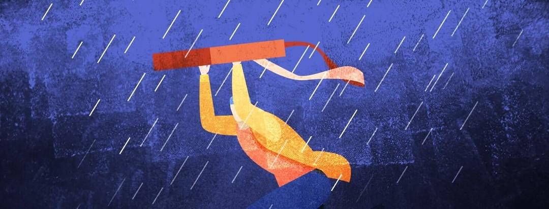 Person running through the rain holding a bag above their head
