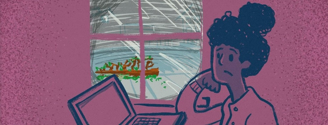 A distracted woman of color leaning on her hand in front of a laptop computer looking longingly out of the cold window. In the window is a dull grey scene that includes a bare Christmas tree on the curb.