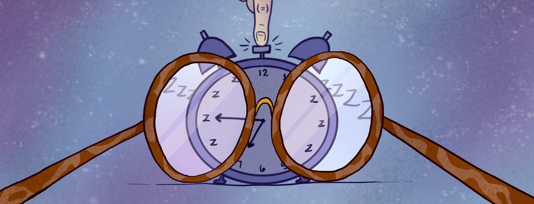 Glasses in front of an alarm clock that only sees zzzz's on the clock face while a finger presses the snooze button