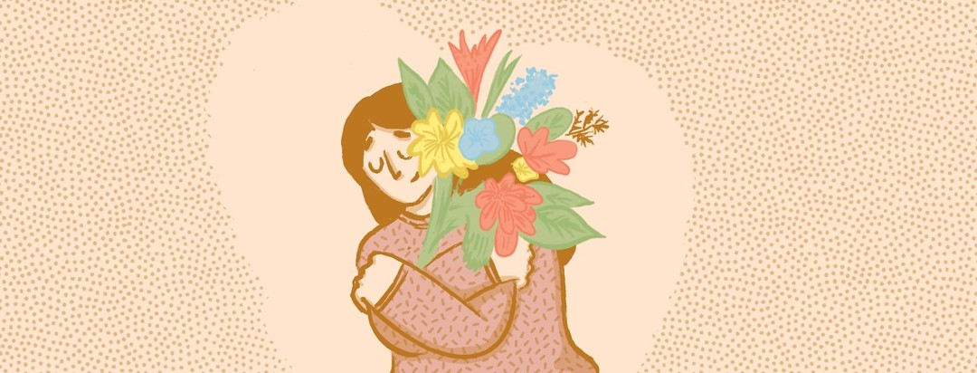A woman hugging a bundle of flowers and smiling peacefully.