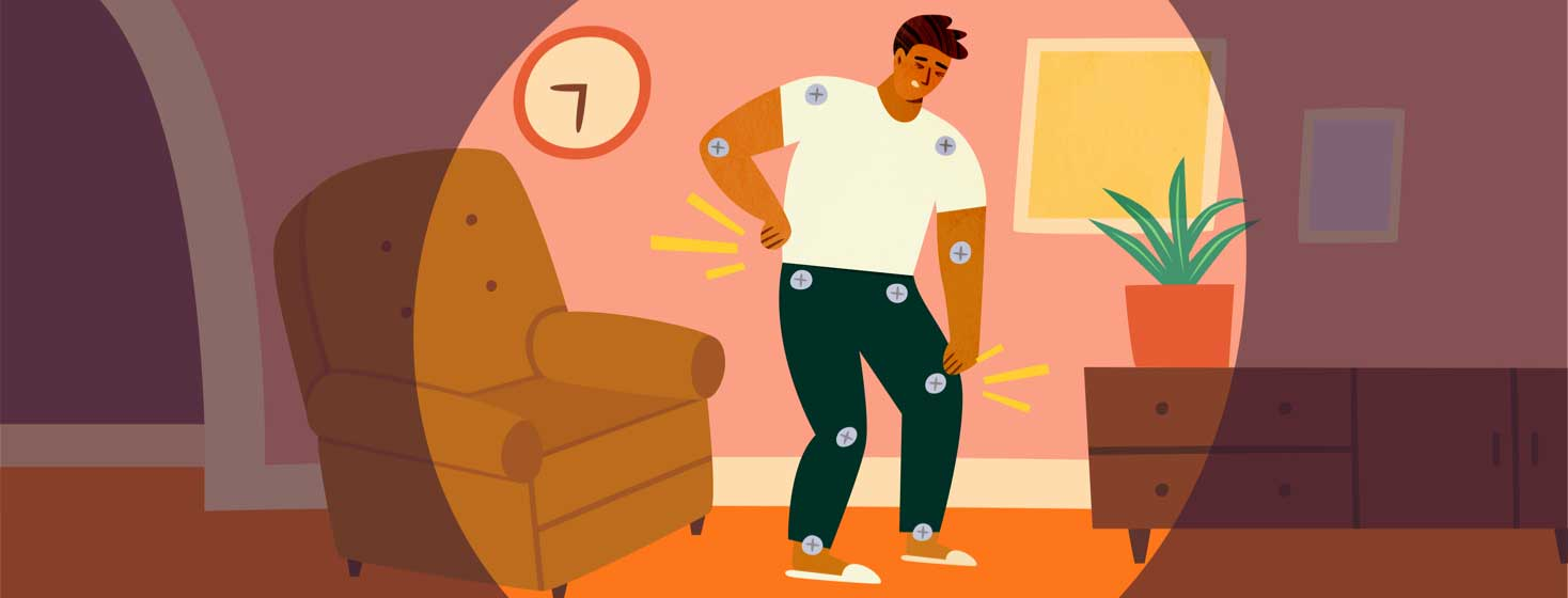 Stiff man with bolts for joints clutching back and knee after getting up from a recliner chair