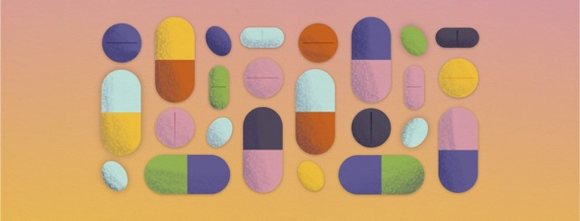 A wide selection of multicolor tablets, pills, capsules, and supplements arranged neatly.