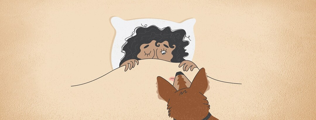 a woman peeking out from covers at a dog