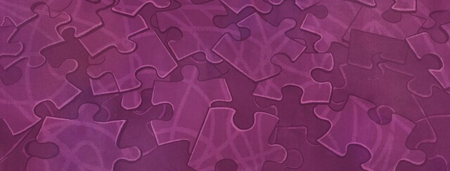 A messy pile of unfinished puzzle pieces.