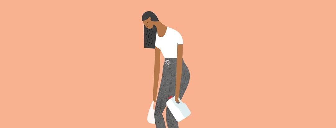 Sad woman carrying a gallon of milk and shopping bag weighing her down