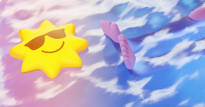 A sunglasses-wearing sun pool toy floating on the water next to a pair of legs and feet floating in the water.